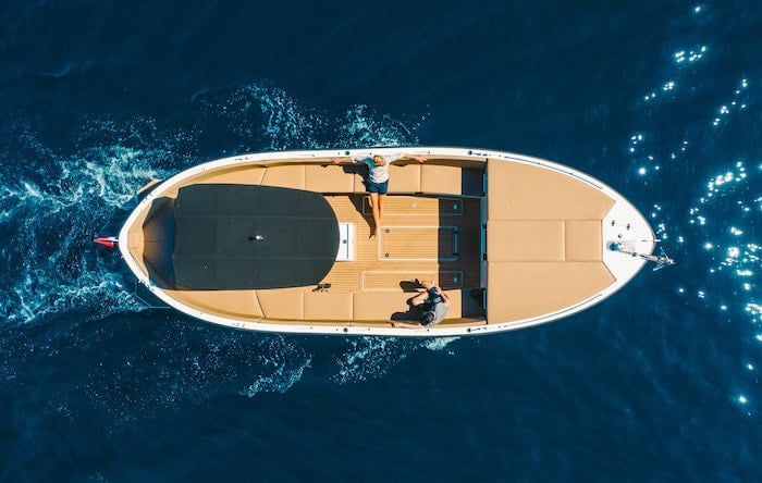 people on boat, picture taken from a bird eye perspective, Five Things Yacht Sellers Should Do Before Contacting A Yacht Broker