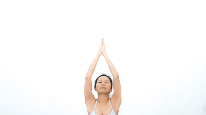 Asian woman is folding her hands to the sky, Exercises You Can Do Onboard to Start Your New Year's Resolution