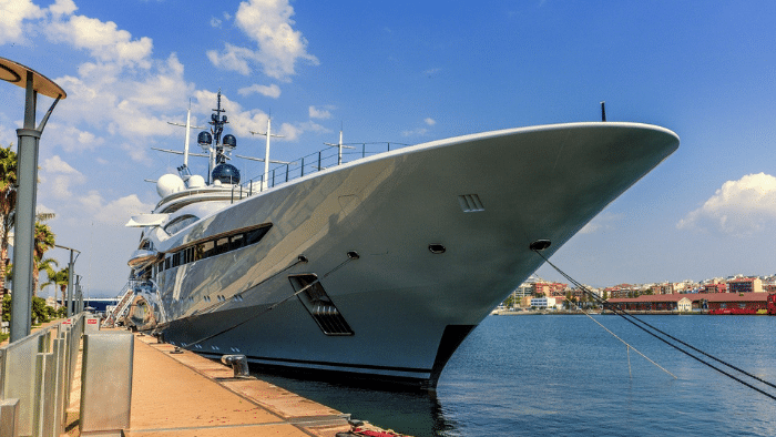 luxury yacht on a pier, yacht hull materials guide
